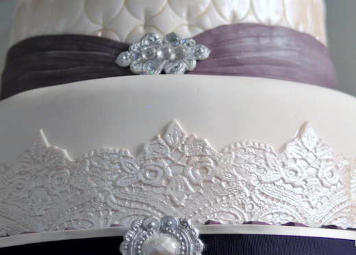 Royal Wedding Cake purple sash beads jewels