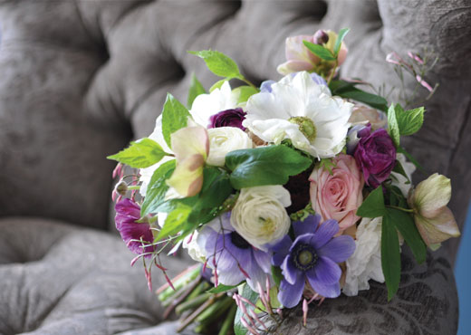 ranunculus, jasmine and anemone bouquet from cover of Seattle Met Bride & Groom
