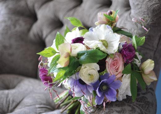 ranunculus, jasmine and anemone bouquet from cover of Seattle Met Bride & Groom