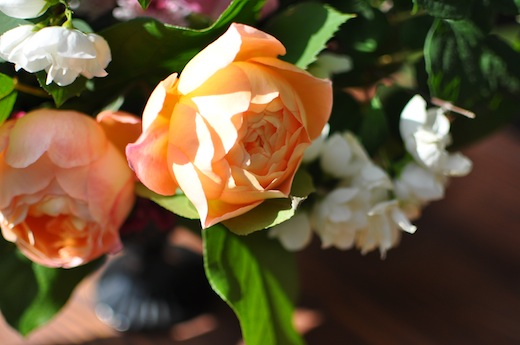 orange david austin rose in an arrangement by finch & thistle event design