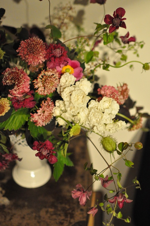 white garden roses, scabiosa and clematis