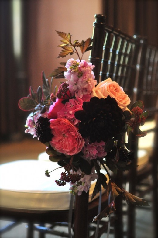 pink and brown chair posy