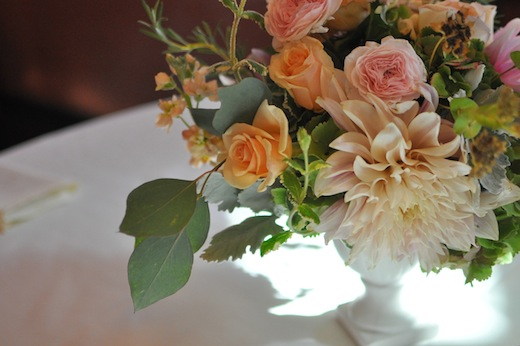 peach and pink wedding flowers with herbs