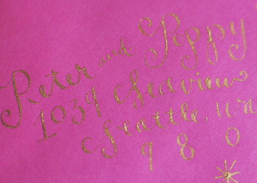 pink envelope with gold calligraphy design sponge