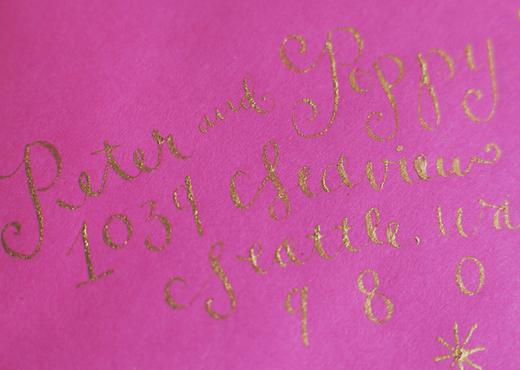 pink envelope with gold calligraphy design sponge