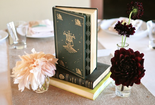 simple book centerpiece with bud vases