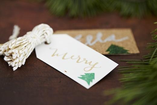 la happy calligraphy finch and thistle escort card design tassels