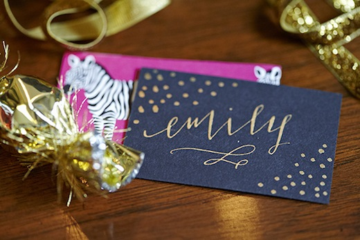 gold calligraphy wedding escort cards favors