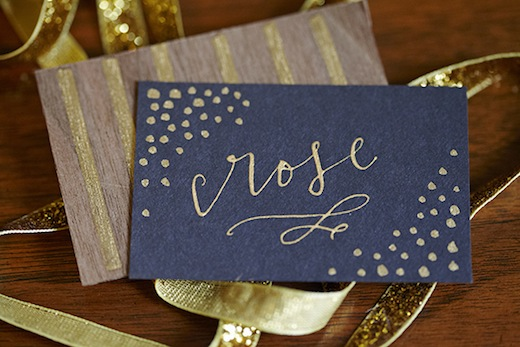 gold and wood escort cards la happy seattle event designer